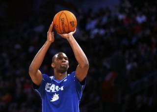 East All-Star Chris Bosh of the Miami Heat takes part in the All-Star Shooting Stars competition during the NBA basketball All-Star weekend in Houston